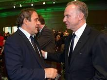 ECA-Chef Karl-Heinz Rummenigge (r.) fand eine Einigung mit UEFA-Präsident Michel Platini